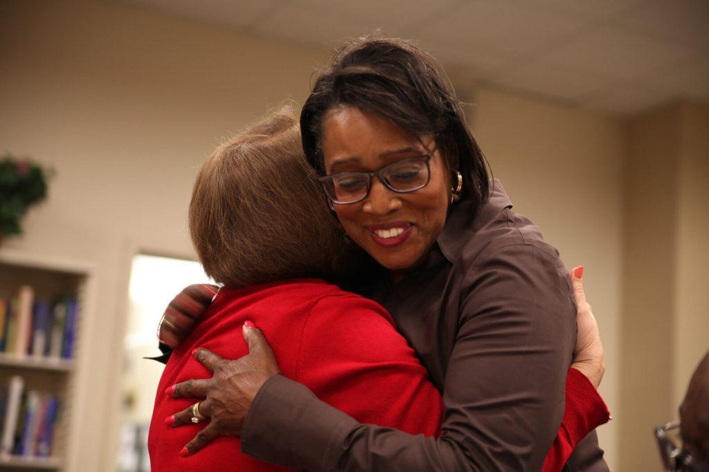 Provost Elizabeth A. Dooley hugging a staff member